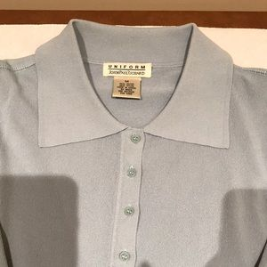 Baby blue pullover with buttons and collar